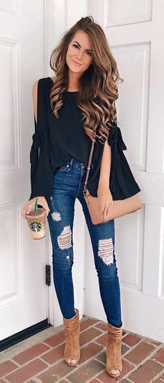 Black cold shoulder top with blue jeans.