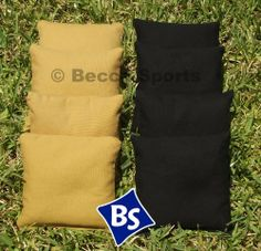 """Weather Resistant Cornhole Bags Set - 4 Black & 4 Gold (Dark Gold) by Becca Sports. $28.00. 6""""x6"""". 8 Regulation Weather Resistant Cornhole Bags (4 Black, 4 Dark Gold). Made with Regulation Duck Cloth. High Quality Bags. Filled with Plastic Pellets. Eight quality weather resistant cornhole bags, 4 Black and 4 Dark Gold. We make our bags to last. Our bags are made out of regulation duck cloth and are stitched to last. The 6""""x6"""" bags are filled with plastic pellet..."""