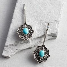 Bold turquoise takes center stage with our decorative hair pins. You'll love the touch of drama they create, embellished by ornately crafted detail in an antiqued silver finish.