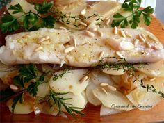 Lomo de bacalao al horno con patatas y piñones