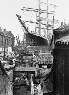 """A sailing ship in dry dock Millwall, East London 1932 [[MORE]] Some info on the ship, if you're interested: """" The S. Penang was a three-masted steel barque built in 1905 in Germany, and was originally named the """"Albert Rickmers"""". In 1910 she was. Victorian London, Vintage London, Old London, East London, London History, British History, Asian History, Tudor History, Old Pictures"""
