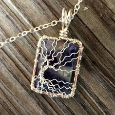 Sterling Silver Wire Wrapped Tree of Life Pendant over Sodalite Gemstone Pendant Handcrafted by Ann White.  This pendant is small in size and hangs 1 1/4 inches (32mm) long from the top of the bail an