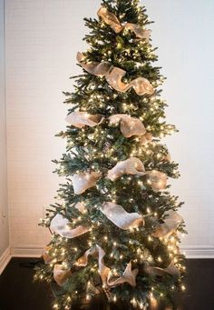 How to Put Ribbon Garland on a Christmas Tree A ribbon is the perfect solution to concealing those bare spots in your Christmas tree while also adding a touch of color and texture. Christmas Tree Ribbon Garland, Unique Christmas Trees, Alternative Christmas Tree, Christmas Tree Themes, Noel Christmas, Xmas Tree, Rustic Christmas, Christmas Lights, Christmas Crafts