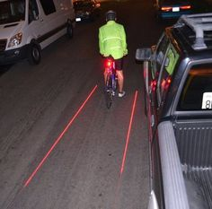 This laser device projects a bike lane that follows your bike as you ride. Tell drivers they should maintain a safe distance from you.