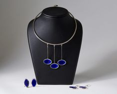 Sterling silver and enamel.