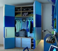 blue tones, closet doors painted in modern squares, closet with fitted shelving  matching colours. looks great. Italian childrens bedroom furniture manufacturer Dearkids has design 2010 Collection of Contemporary Childrens Bedrooms. this bedroom very stylish and comfortable.