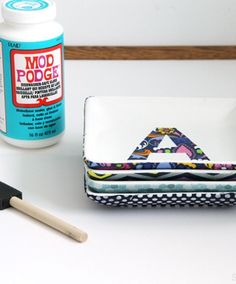 Easy DIY Project // Monogram Mod Podge Dishwasher Safe Fabric Platters // Supplies available at Joann.com