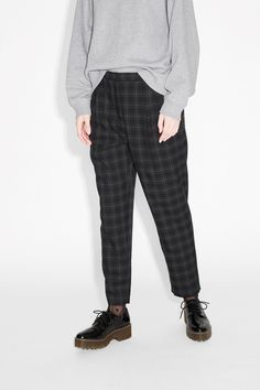 Relaxed, tapered trousers cut from an Oxford professor-ish check fabric. Hook and bar closure, with some elastic in back for extra comfiness. Slant pockets.