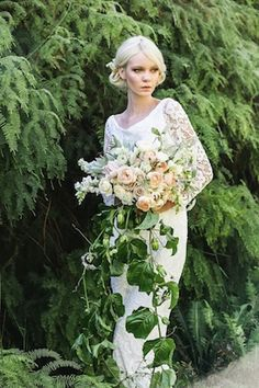 Cascading bridal bouquet | Lara Hotz Photography for Hooray Magazine with styling by Stefanie Ingram, beauty by Liv Lundelius Makeup Artist and floral design by Jardine Botanic Floral Styling | see more on: http://burnettsboards.com/2014/07/ophelia-enchanting-fashion-boudoir-editorial/