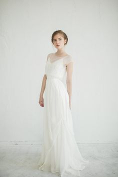 This is beautiful ivory wedding dress with illusion neckline lace top. Follow the link to watch the video with this dress