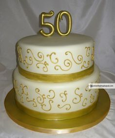 Golden 50th Anniversary -  this is nice and simple - ribbon, corneli and big 50 on gold board.