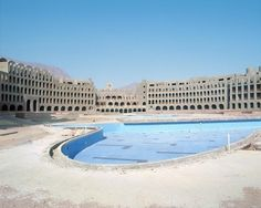 CONCRETE SKELETONS: ABANDONED HOTEL PROJECTS OF THE SINAI PENINSULA Between 2002 and 2005, German photographers Sabine Haubitz and Stefanie Zoche traveled to Egypt's Sinai peninsula. There, the skeletons of abandoned 5-star hotel projects stand in a...