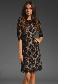 black lace twist to little black dress