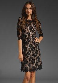 black lace twist to little black dress