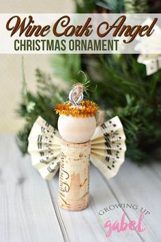 Click now to see how to use wine corks to make an DIY wine cork angel Christmas ornaments for your Christmas tree with sheet music wings and a gold pipe cleaner halo. Easy to make. #winecorkcrafts #christmasornaments #angelornament