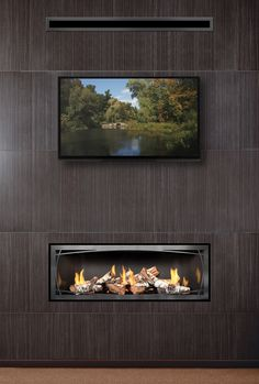 "Wondering what these ""fall"" and ""winter"" things we keep mentioning are? Well, warm weather friends, have we got news for you — a fireplace can still transform your living area into a stunning style showcase without overheating your home. Learn about heat transfer systems."