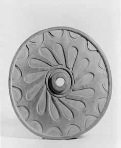 Spindle Whorl (Sulsultin) Carved with Wheel Design  Culture: Chemainus, Coast Salish, Native American  Medium: Cedar wood  Place Made: Chemainus, Vancouver Island, British Columbia, Canada  Dates: late 19th century  Dimensions: 8 7/8 x 9 1/4 in. (22.5 x 23.5 cm)