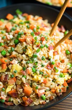 for breakfast! This tasty cauliflower rice is sauted with colorful veggies, fluffy eggs, and crispy bacon, then drizzled with a h Vegetarian Breakfast, Breakfast Bowls, Breakfast Recipes, Breakfast Ideas, How To Cook Cauliflower, Cauliflower Fried Rice, Cauliflower Recipes, Healthy Vegetables, Veggies
