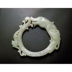 Pendant with dragons Place of Origin: China Date: approx. 1900-1949 Object Name: Jewelry Materials: nephrite