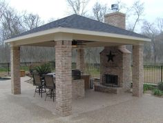 outdoor patio with fireplace and grill Austin Detached Covered