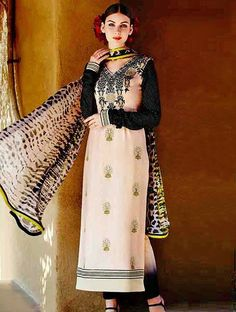 Make yourself cherish & pampered in this admirable peach & black cotton satin designer suit. Exquisite embroidery work make the apparel amazingly gorgeous. #blacksuit #creamsuit #designersuit #lookbuylike