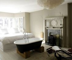 Freestanding Bathtub In the Bedroom No Clear Separation Of Bath From Chandelier Over Clawfoot Tub – Gazebo And Grill Design Ideas Bedroom With Bathtub, Master Bedroom, Open Plan Bathrooms, Small Bathroom, Loft Bathroom, Vintage Tub, Bedroom Vintage, Eclectic Fireplaces, White Wash Wood Floors