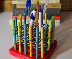 What a great use for those old Tinker Toys! Make a rubber band pencil/pen holder.