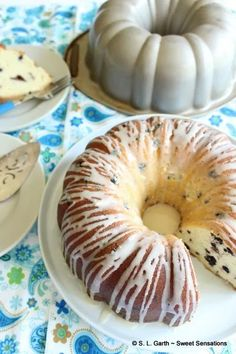 There's nothing like relaxing with a slice of Amaretto Glazed Berry Bundt. Unless of course, you enjoy a glass of champagne or another beverage with it. Glass Of Champagne, Doughnut, Glaze, Berry, Beverages, Sweet, Desserts, Food, Enamel