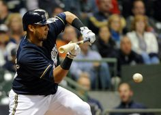 CrowdCam Hot Shot: Milwaukee Brewers catcher Martin Maldonado drops down a bunt to squeeze in a run in the fourth inning during the game against the Chicago Cubs at Miller Park. Photo by Benny Sieu