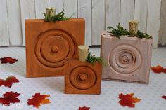 Typically found around doorways, these wood trim corner blocks get cute second job as rustic pumpkins.  Get the tutorial at Average But Inspired »   - GoodHousekeeping.com