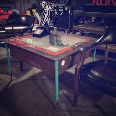Using salvaged items from around the store  Thad created a killer industrial coffee or end table.  @eyewtkas converted an old fire hose box and posts from a raised computer floor to make this piece.  #savedfromthescrapper #reuse #salvagedindustrial #indysalvage #societyofsalvage #hardworker