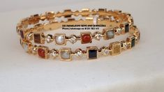 Fine quality Navaratnas and Pure Diamonds bangles in 22kt Close setting. Visit for exclusive designs. Phone no 8125 782 411 09 September 2019