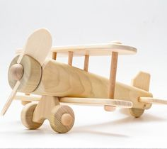 Beautiful handcrafted Eco-friendly Wooden Bi-plane by Leonardo Toys Italy (only… Wooden Airplane, Wooden Toy Cars, Wood Toys, Making Wooden Toys, Handmade Wooden Toys, Wooden Diy, Toys For Boys, Kids Toys, Woodworking Toys