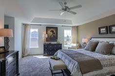 The spacious master bedroom is a huge feature of the Mackenzie model. This home is on the Harrisburg Parade of Homes. Ceiling Detail, Parade Of Homes, Warm Colors, Master Bedroom, Living Room, Tray Ceilings, House, Furniture, Bedrooms