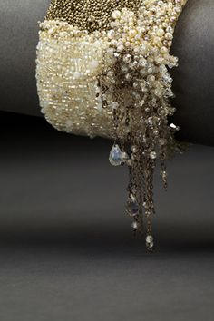 Dangle Couture Cuff - Pearls, white moonstones, grey moonstones, vintage glass seed beads, vintage metal seed beads, vintage crystals, cubic zirconias and sterling silver hand embroidered on heavy silk with a hammered-silver clasp.
