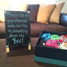 Created this sign for our house warming party. It's a polite way to ask guests to take off their shoes before entering your home. The new socks were the perfect party favor!