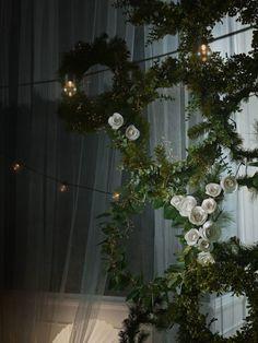 Ikea wreath decor with string lights.