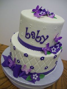Purple Butterflies - 6 and 8 inch tiers iced in buttercream with fondant decorations.