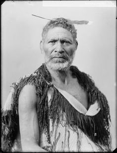 Tamarere, Maori chief from Atene and Koriniti, photographed by William Henry Thomas Partington, circa 1895. He wears a long feather in his hair (close to the forehead hairline) and a korowai (tag cloak). He has a facial moko, beard and moustache.