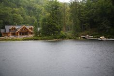 This luxurious log home has three bedrooms, two baths, three fireplaces and a wood-burning stove.