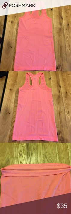 Lululemon Swiftly Razorback Tank Size 2. Bright salmon color. Perfect condition - just too tight on me. lululemon athletica Tops Tank Tops