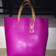 Victoria Secret tote bag This is a very sturdy tote. It is pink with tan handles an inside an still has the keychain the hangs on the straps. Victoria's Secret Bags Totes
