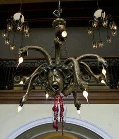 Chandelier depicting the Gorgon, Medusa. My son is medusa obsessed, he would adore this. Gothic Furniture, Unusual Furniture, Gothic House, Gothic Mansion, Gothic Home Decor, Haunted Mansion, Macabre, My Dream Home, My House