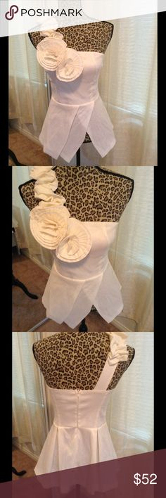 Peplum fancy floral top New, ivory/cream color, zips in back, floral design embellishment on shoulder strap, bought for a wedding and never wore, this really is a beautiful top, would look great w/ a skirt, shorts, and legging/pants Tops Blouses