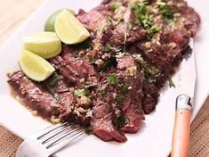 Skirt steak, with its coarse texture and hearty grain is a great cut for marinating, particularly when the marinade is a garlicky mix of lime and orange juice. As it chars over a hot flame, the interior ends up buttery and rich.