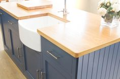 In-frame style island painted in Stiffkey Blue. Modern yet elegant design features an Appalachian White Oak worktop.  www.nakedkitchens.com/kitchens/