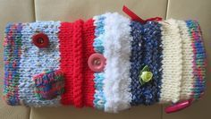 Have you heard of 'Twiddlemuffs'? Twiddlemuffs are knitted woollen muffs with items such as ribbons, large buttons or textured fabrics attached that patients with dementia can twiddle in their hands. People with dementia often have restless hands and like something to keep them occupied. The Twiddlemuffs provide a source of visual, tactile and sensory stimulation at the same time as keeping hands snug and warm. Great idea aren't they?