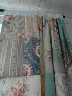 vintage fabric patchwork curtains  I would use vintage table clothes cut into squares for kitchen curtains