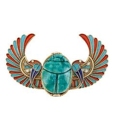 Egyptian Revival Gold, Carved Faience Scarab and Enamel Pin. Centring a turquoise blue faience scarab, flanked by blue, turquoise and orange enamel serpents and wings of deep turquoise and reddish-orange enamel, all outlined in fine rope-twist gold, circa 1870.