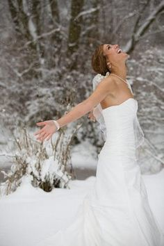 Embrace winter! Love this this would be a great idea for trash the dress. Have you, the groom and the wedding party have a snowball fight